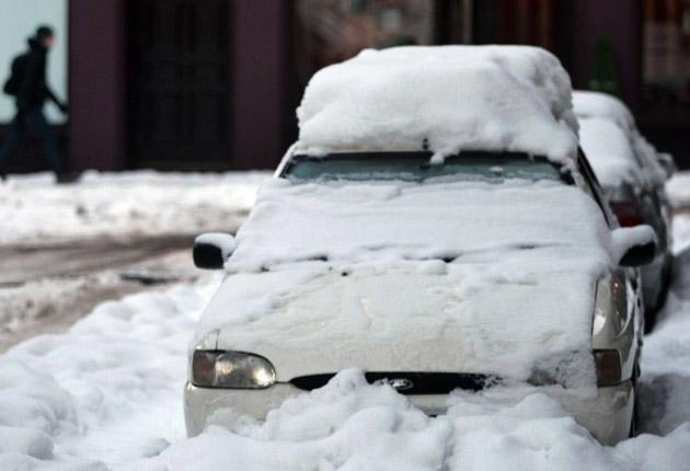 A snow-covered car in Edinburgh. Elsewhere in Scotland hundreds of drivers were stuck in their vehicles overnight.