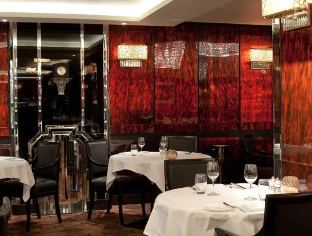 Beautiful re-design: The remodelled Grill room is moodily lit and glamorous, with dark, lacquered walls that give the impression of being inside a glowing tortoiseshell box