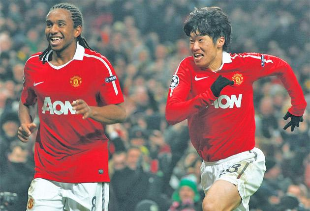 Anderson (left) and Ji-Sung Park celebrate the former's goal for Manchester United against Valencia on Tuesday