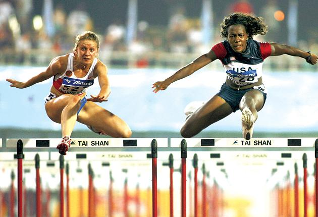No international barriers: Tiffany Ofili (right) competes against Russia's Yekaterina Shtepa in the colours of the United States in the 100m hurdles final at the World Junior Championships in Beijing in 2006