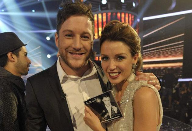 Matt Cardle with his judge and mentor Dannii Minogue and a copy of his Christmas single