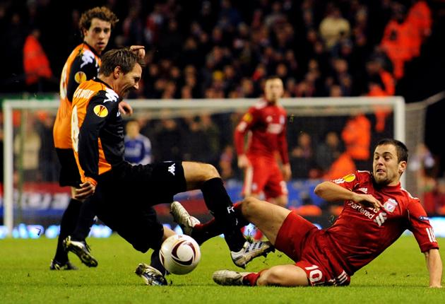 Joe Cole battles for the ball during the UEFA Europa League match between Liverpool and FC Utrecht
