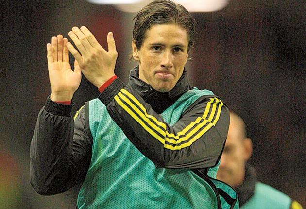 Fernando Torres applauds the fans from the touchline - the nearest he came to the pitch
