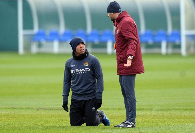 Roberto Mancini is considering temporarily removing the Manchester City captaincy from Carlos Tevez