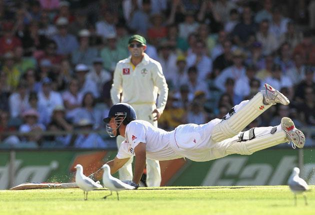 Alastair Cook dives to make his ground and survives a close run-out call during a bad day for England