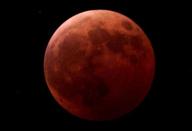 The partial eclipse begins when the Moon first enters the dark inner, umbral part of the Earth's shadow, and will become a total eclipse at 7.40am
