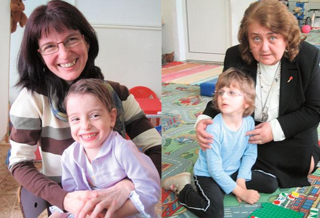 Mihaela Hagima and her daughter Alexia, left, who attends the Sansa Mea centre, a special needs facility in Iasi, north-eastern Romania, founded by Dr Olimpia Macovei, right