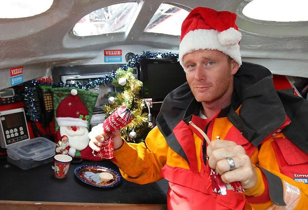 Chris Stanmore-Major  opens his Christmas cracker while thousands of miles from land, deep in the Southern Ocean on his way from Cape Town to Wellington