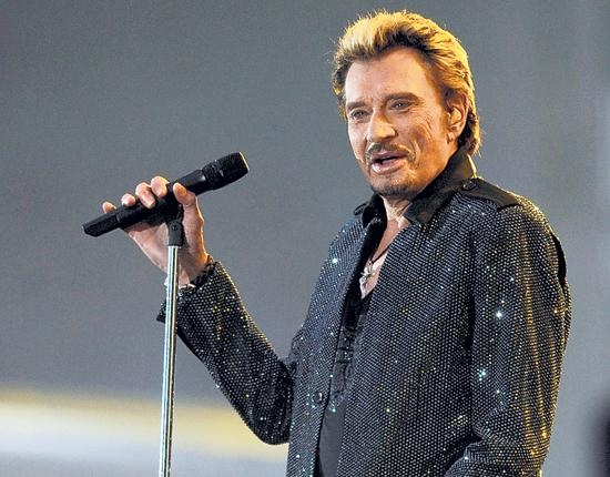 Encore! The indomitable half-Belgian singer Johnny Hallyday shows no signs of slowing down despite a near-death experience in California a year ago