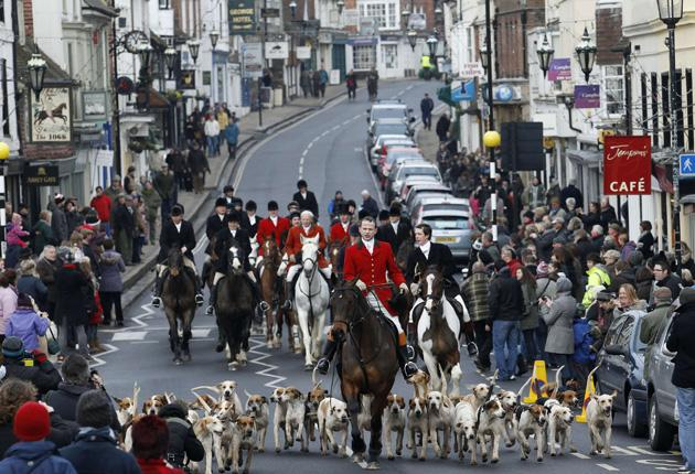 The East Sussex and Romney Marsh Hunt making its way through the streets of Battle in East Sussex
