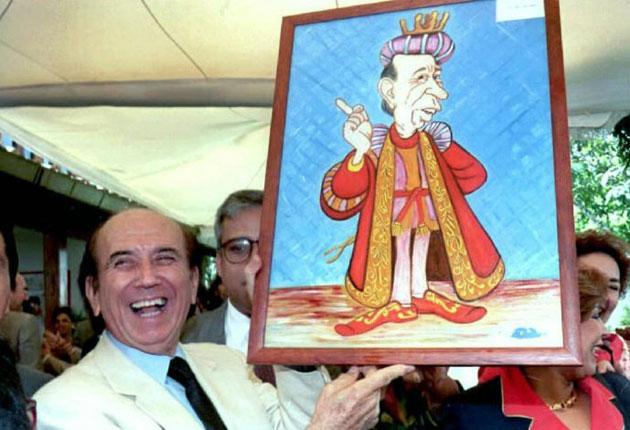 Perez in 1995, while under house arrest, with a caricature of himself which he received for his 73rd birthday