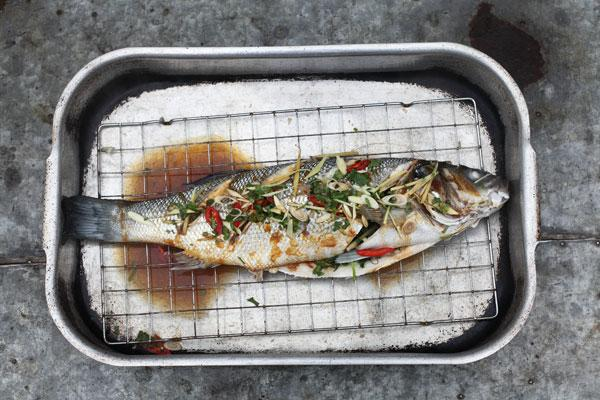 Baked sea bass with ginger, chilli and coriander