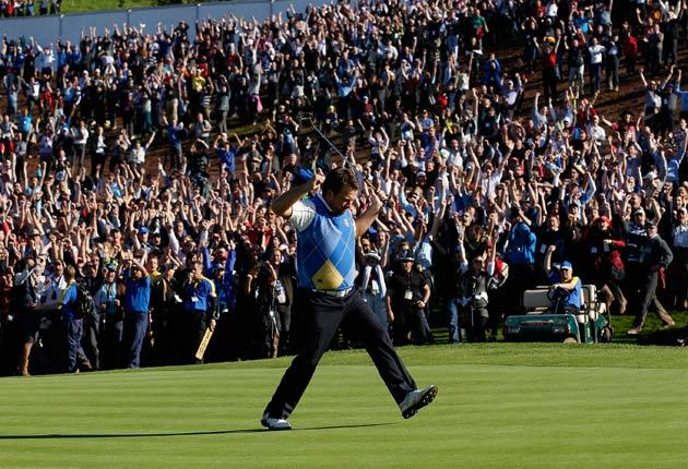 Graeme McDowell of Europe celebrates his birdie putt on the 16th green