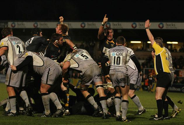Wasps celebrate as Serge Betsen is driven over for a try against Newcastle