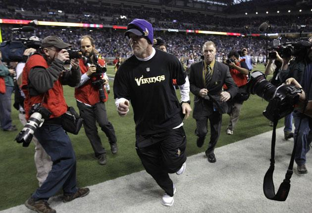 Minnesota Vikings quarterback Brett Favre runs off the field for the final time after his side's defeat to the Lions in Detroit