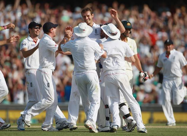 Chris Tremlett of England is congratulated after taking the wicket of Mitchell Johnson