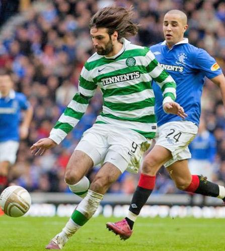 Celtic striker Georgios Samaras (left) beats Rangers' Madjid Bougherra to the ball during the Old Firm game earlier this month
