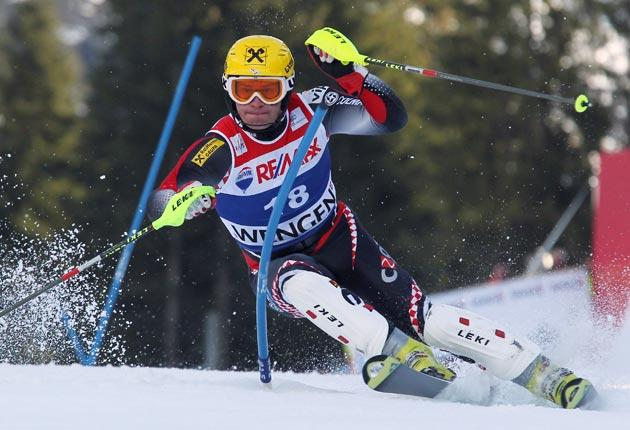 Croatia's Ivica Kostelic races downhill on his way to victory in the World Cup super-combined slalom race in Wengen, Switzerland