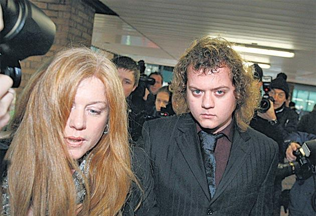 Edward Woollard arrives at court this week clutching his mother's hand