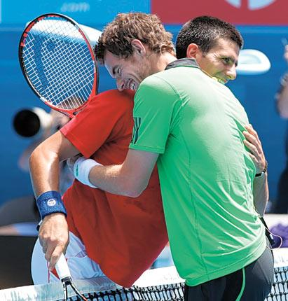 Andy Murray (right) and Novak Djokovic share a light-hearted moment during a charity exhibition match yesterday at the Rod Laver Arena, Melbourne