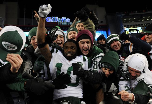 The Jets stopped top seeds New England and Tom Brady 28-21 on Sunday night