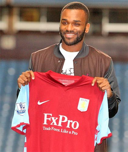 Darren Bent holds the shirt of his new club, Aston Villa, amid recriminations from Sunderland, where manager Steve Bruce has accused him of letting down fans
