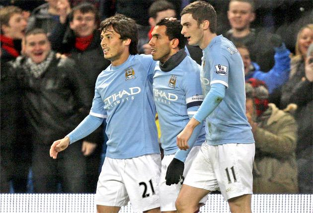 Adam Johnson (right) enjoys Manchester City's FA Cup victory on Tuesday with David Silva (left) and Carlos Tevez