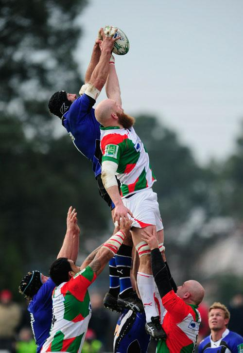 Second-rower Erik Lund (right) jumps in the line-out with Bath's Danny Grewcock during a bonus-point victory for Biarritz in the Heineken Cup