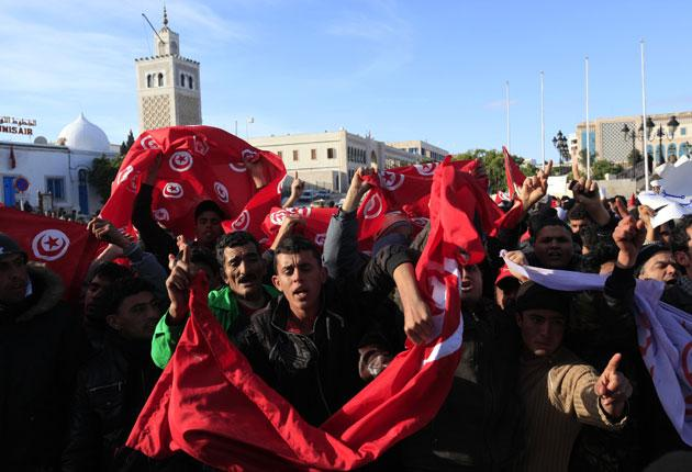 Protesters chant slogans during a demonstration in Tunis yesterday