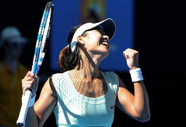 Li Na of China gestures as she celebrates after victory in her women's singles semi-final match against Caroline Wozniacki of Denmark on the eleventh day of the Australian Open tennis tournament in Melbourne