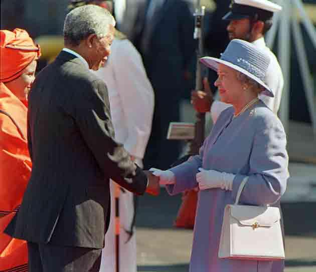 President Mandela greets Queen Elizabeth II on her official arrival at Cape Town's Waterfront in 1995