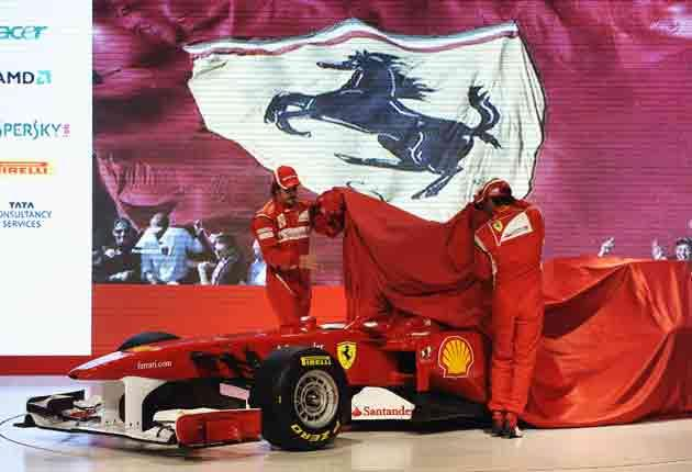 Team-mates Fernando Alonso and Felipe Massa were on hand to pull the red silk wrap from the chassis of the new challenger at Ferrari's Maranello headquarters