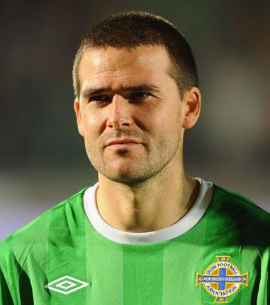 Northern Ireland striker David Healy has joined Rangers on a permanent deal