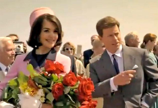 Katie Holmes and Greg Kinnear as Jack and Jackie Kennedy