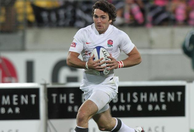 England's Mat Turner runs in a try during their 33-7 win over Wales on the opening day of the Wellington IRB Sevens at the Westpac Stadium yesterday