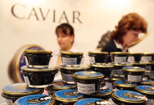 Jars of caviar on display at a food fair.  Sales of the luxury food have been restricted to protect the sturgeon