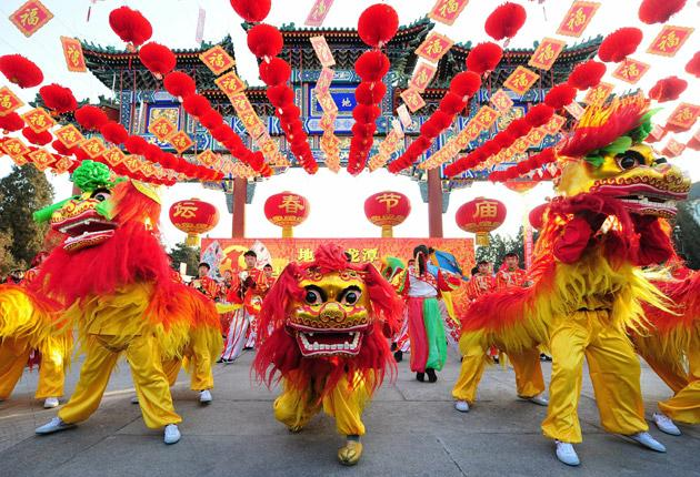 Roaring trade: Lion dancers celebrate the Chinese New Year in Beijing