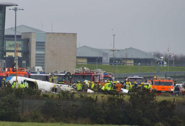 Emergency services attend the scene after the plane crash at Cork Airport