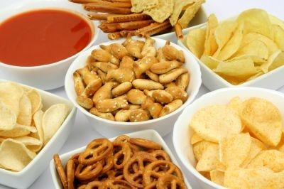 A new report reveals that Canadians and Americans are divided when it comes to salty and sweet snacks. Can you guess which country is expected to consume more savory snacks over the next 10 years?