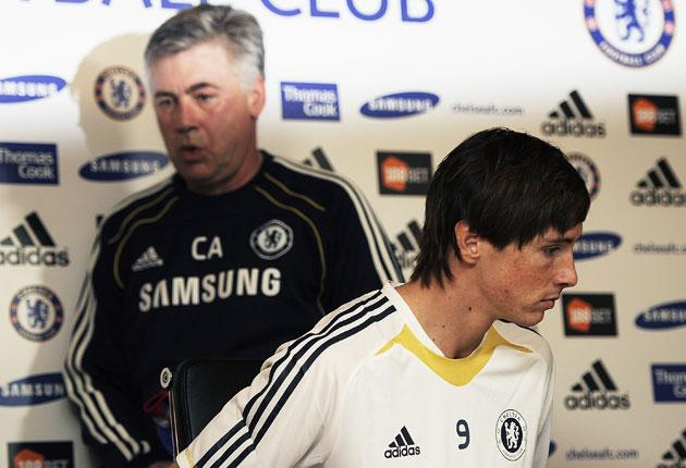 The rules enabled Chelsea to spend £50m on Fernando Torres (right), say critics