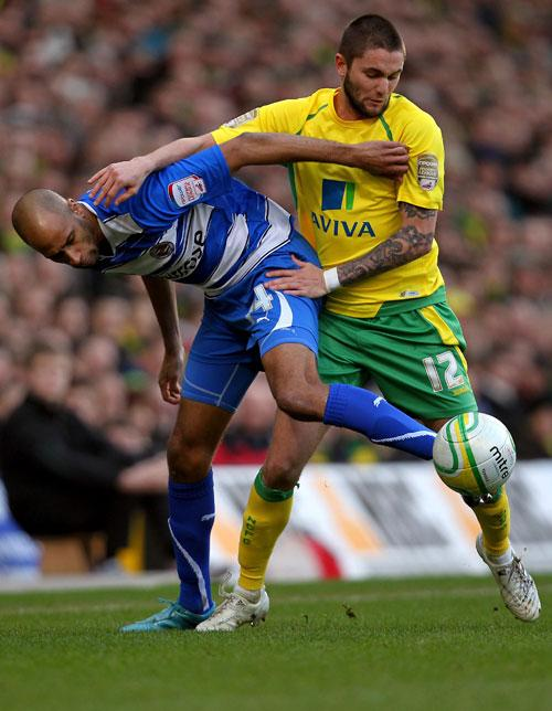 Norwich's Henri Lansbury and Jimmy Kebe (left) get in a tangle