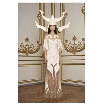 For the past two seasons, Riccardo Tisci, creative director at Givenchy, has shown his haute couture collection [pictured] to small groups in a grand Parisian town house