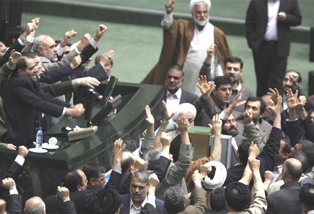 Members of the Iranian parliament shout slogans in Tehran yesterday