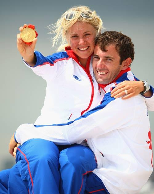 Sarah Ayton poses with her partner Nick Dempsey after winning gold at the 2008 Olympics