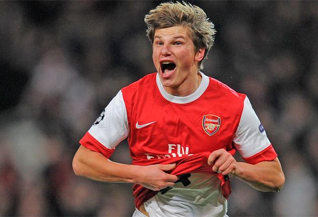 Andrey Arshavin celebrates scoring Arsenal's second, giving them a famous victory