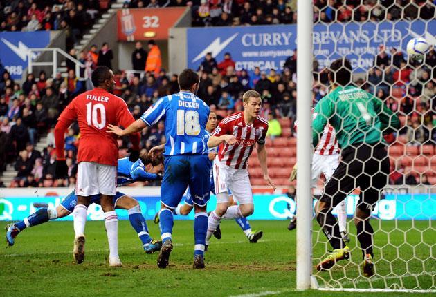 Stoke defender Ryan Shawcross scores his side's third goal past Brighton goalkeeper Peter Brezovan (right)