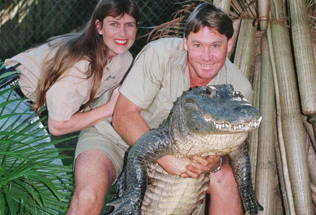 Steve Irwin holds an alligator, with his wife, Terri, at the Australia Zoo in Queensland