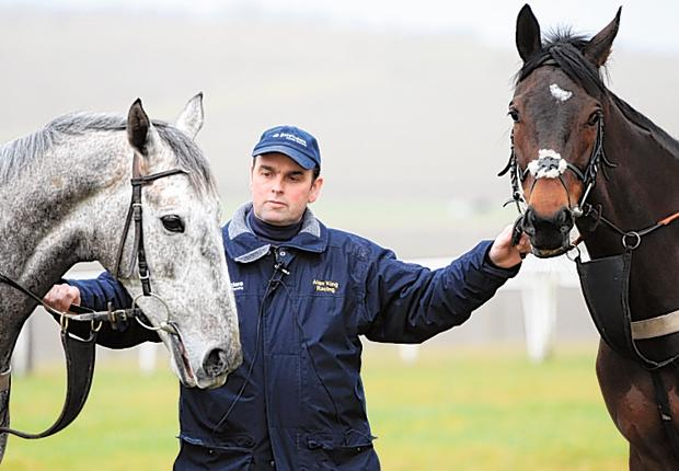 Trainer Alan King holds court with two of his Cheltenham Festival hopes, Medermit (left) and Mille Chief, at his Barbury Castle stables in Wiltshire yesterday