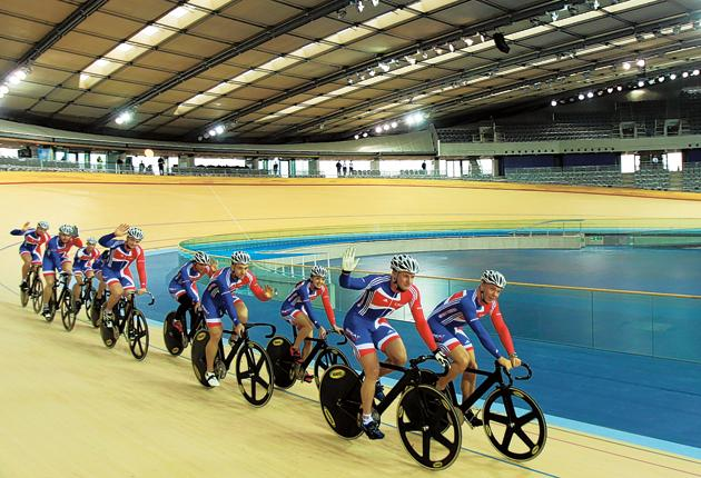 Matthew Crampton and Sir Chris Hoy (right) lead Team GB cyclists around the London 2012 velodrome yesterday