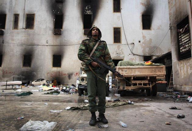 An anti-Gaddafi militiaman amid the carnage of Benghazi